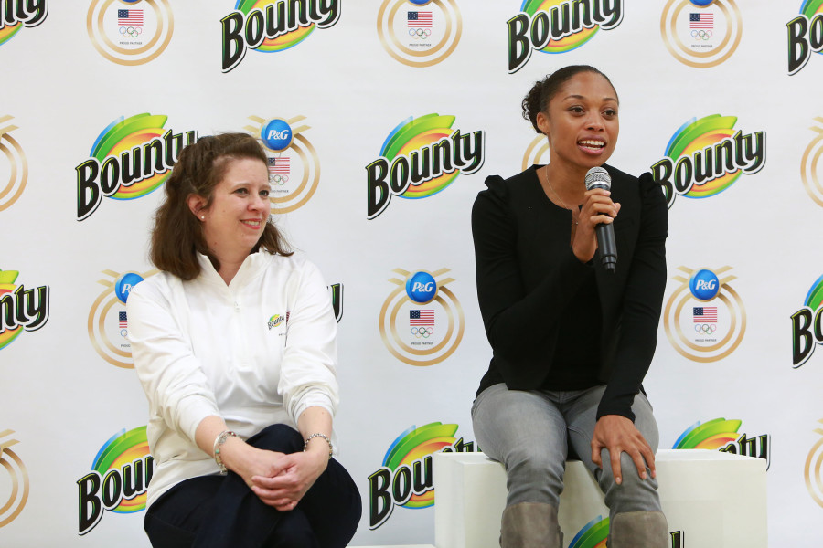 Procter & Gamble (P&G) representative Victoria Schooler and Olympic Sprinter and Gold Medalist Allyson Felix welcome attendees to the ÒBounty 2016 Quicker Picker Upper GamesÓ event, on Thursday April 28, 2016 in New York. The event invited attendees to join Team Quicker Picker Upper and compete in fun and messy activities. (Photo by Amy Sussman/AP Images for Bounty)
