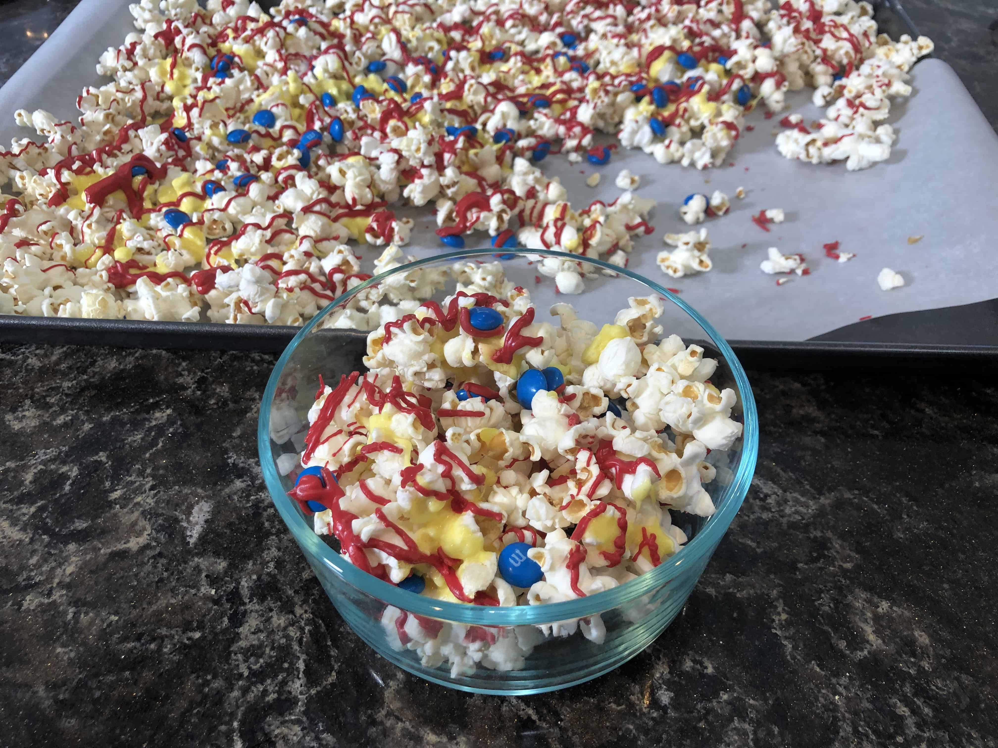 Looking for a fun new superhero popcorn recipe for movie night? Check out this sweet Captain Marvel themed popcorn with red, blue and yellow -- the colors of the movie! #captainmarvel #disneyrecipes