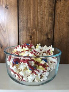 Looking for a fun new popcorn recipe for movie night? Check out this sweet Captain Marvel themed popcorn with red, blue and yellow -- the colors of the movie! #captainmarvel #disneyrecipes