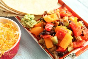 vegetables with guacamole and tortillas and shredded cheese