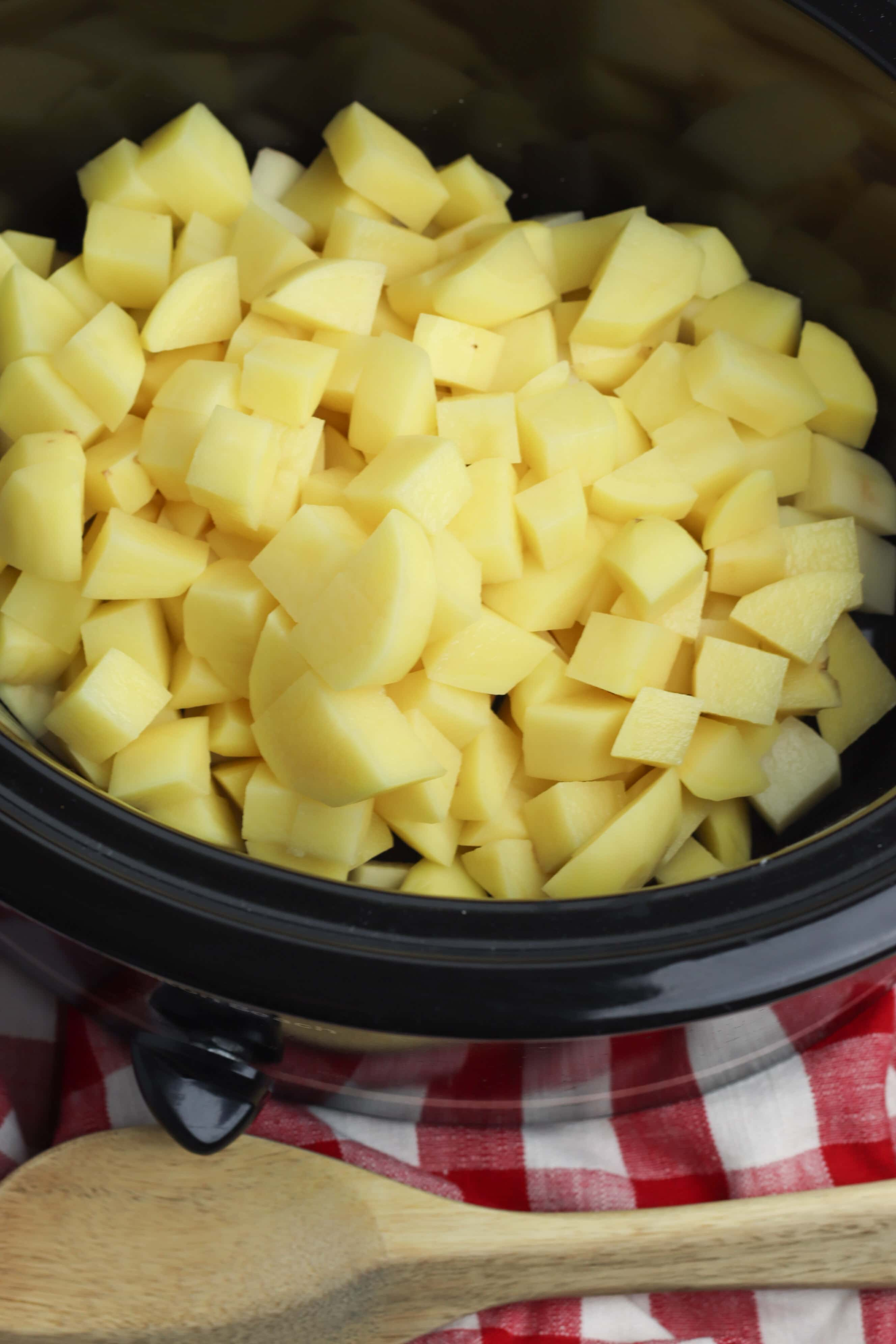 This crockpot mashed potatoes with cheddar recipe takes requires no boiling. It's perfectly delicious for thanksgiving or your next dinner party!