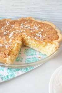 This coconut cream pie recipe features a yummy and creamy coconut filling, can be used with your favorite pie crust, and topped with coconut shavings. Perfect for Thanksgiving and anytime.