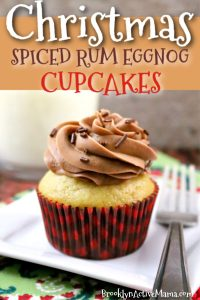 These Spiced Rum Eggnog Cupcakes with Buttercream Frosting are the perfect holiday treat! This easy recipe is awesome for holiday baking! Both the homemade frosting and the cupcake batter have a splash of spiced rum and the cupcake is topped with chocolate sprinkles! These Christmas Cupcakes are sure to please! #ChristmasCupcakes #Eggnogrecipes #holidaybaking #eggnoggcupcakes