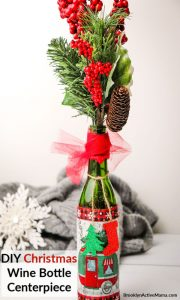 This Christmas Table DIY centerpiece is super easy to make and great to give as a hostess gift! This craft uses simple materials you likely have at home! This craft uses a wine bottle, modge podge, tulle and ribbon for a beautiful centerpiece that will level up your Christmas decor! #ChristmasDIY #ChristmasDecor #diychristmas #christmascenterpiece