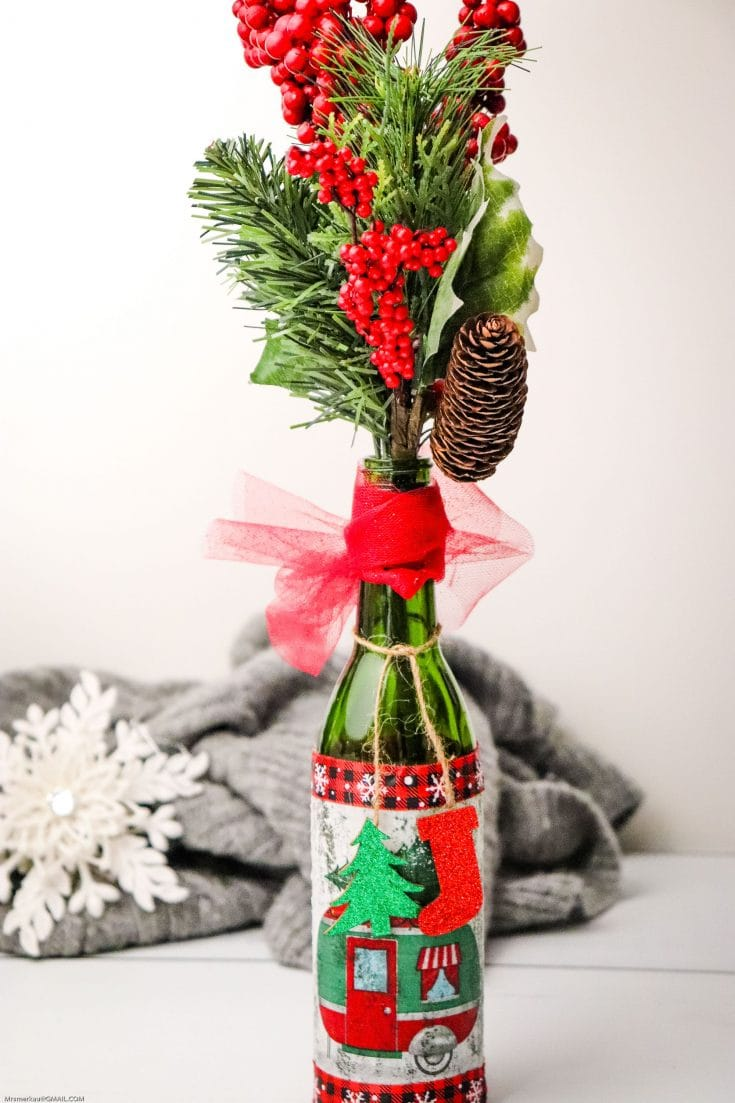 This Christmas Table DIY centerpiece is super easy to make and great to give as a hostess gift! This craft uses simple materials you likely have at home!