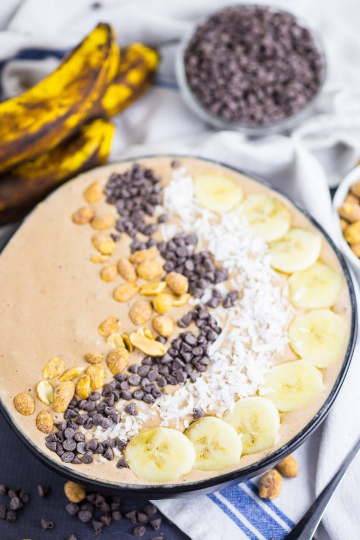 This Chocolate Peanut Butter Smoothie Bowl is quite healthy and it's a great way to feed your family breakfast or a treat that is full of nutrients! Full of amazing flavors and you can vary the toppings however you like! You can use granola, banana, coconut, chocolate chips and so much more. #healthyeating #smoothiebowl #breakfast #chocolatepeanutbutter