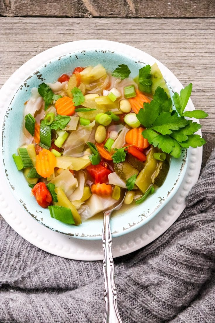 Check out this yummy and hearty homemade vegetable soup recipe filled with tons of nutrients and immunity building veggies! This vegetarian recipe will help fight the flu and is full of flavor! Easy to follow, you may already have all you need to make this yummy soup! #vegetablesoup #vegetarian #vegetables #healthyeating