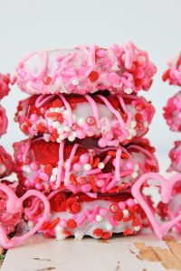 These fun and delicious thumbprint Valentine's Day cookies are a bright red color and decorated with white, red and pink sprinkles. They are perfect to take for a school snack for your kids (Valentine's Day is on a Friday this year!). Or even a for a classroom party. You can make these for the household or even a special treat for your coworkers. #valentinesday #vday #valentinecookies