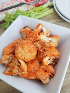 This super easy buffalo air fryer cauliflower recipe is so simple to make with only two ingredients! it is the perfect side dish or big game appetizer! #healthyappetizers #cauliflowerrecipe #vegetableappetizer