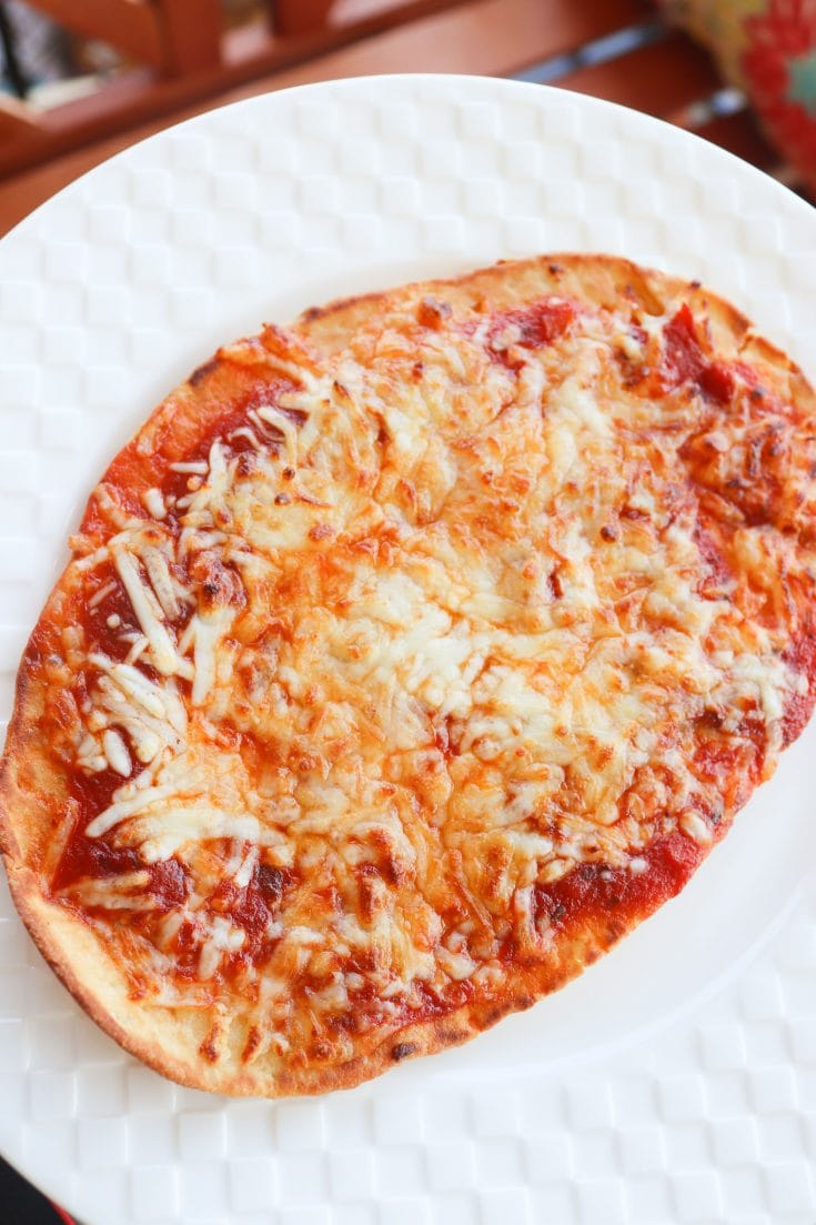 A super easy and quick meal for the family. Air Fryer Pizza has 4 easy ingredients and can be made in only 15 minutes!