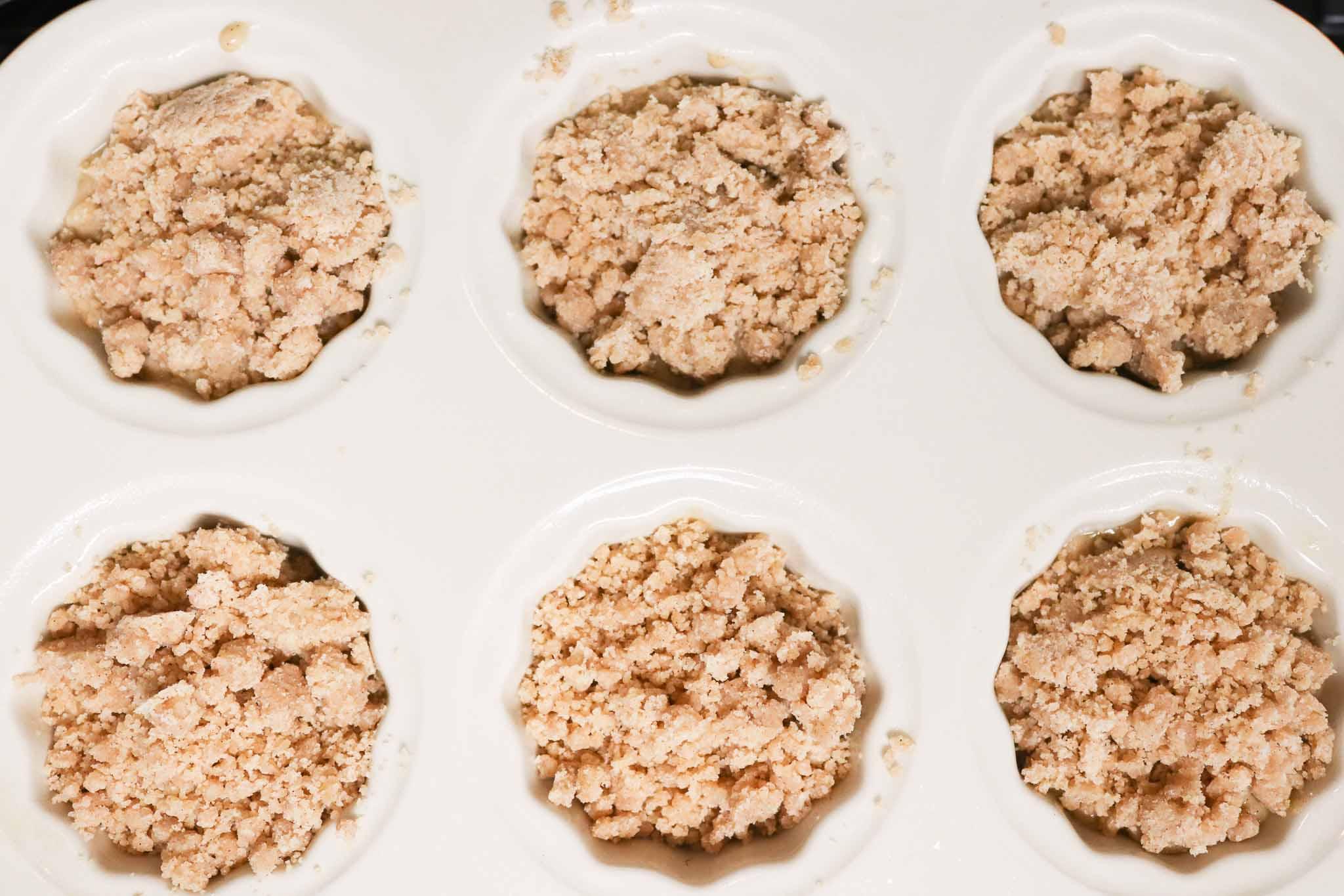 coffee cake muffins in a ceramic muffin tin