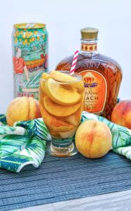Peach Crown Royal Tea with peaches and crown royal bottle
