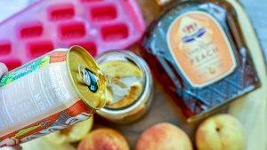 Peach Crown Royal Tea pouring juice