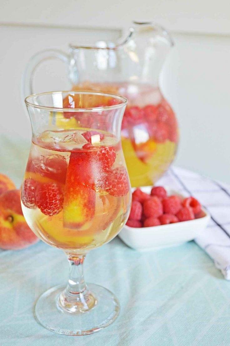 Sweet Wine Peach Sangria Recipe With Fresh Peaches and Raspberries